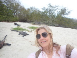 Me at Tortuga Bay Galapagos with the iguanas